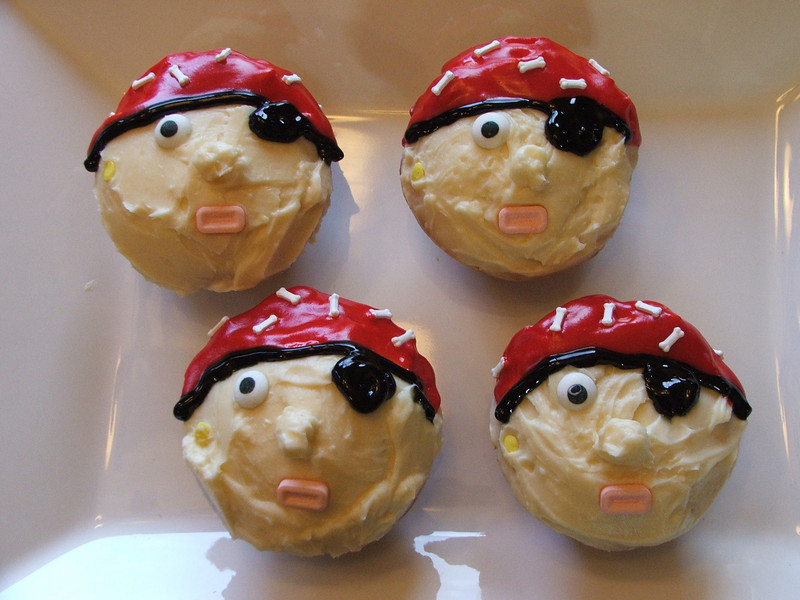 I made these Pirate cupcakes for Jayden's classmates =D I used cream cheese frosting (recipe below) and the eyes are candies from a candy kit at Target also in that kit was these little bone candies pictured on the cap....the kit was purchased during Halloween. The mouth was made from pez candies. I used a light peach food coloring for the cream cheese frosting. The cap and eye patch is frosting from the tube at Safeway lol! Here is the cream cheese frosting: Ingredients 1 pound cream cheese, softened 4 cups sifted confectioners' sugar 1 cup unsalted butter softened 1 teaspoon vanilla extract 1 teaspoon lemon extract (optional) Instructions Mix cream cheese with butter until smooth. Add extracts. Slowly add sugar and blend until light and fluffy! Fill and Ice cake as desired. Pecans can be added to top of cake for decoration. Use a piping bag with a round #8 tip to create fluffy cupcake tops!